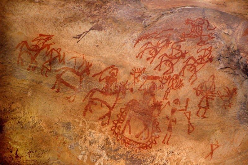 Arte primitiva na parede da caverna foto de stock royalty free