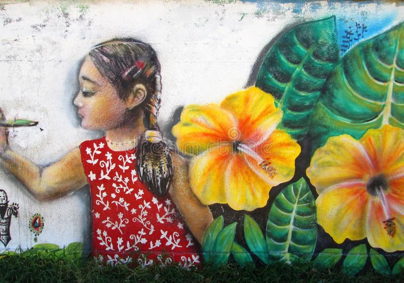 Arte urbano Muchacha y flores imagen de archivo