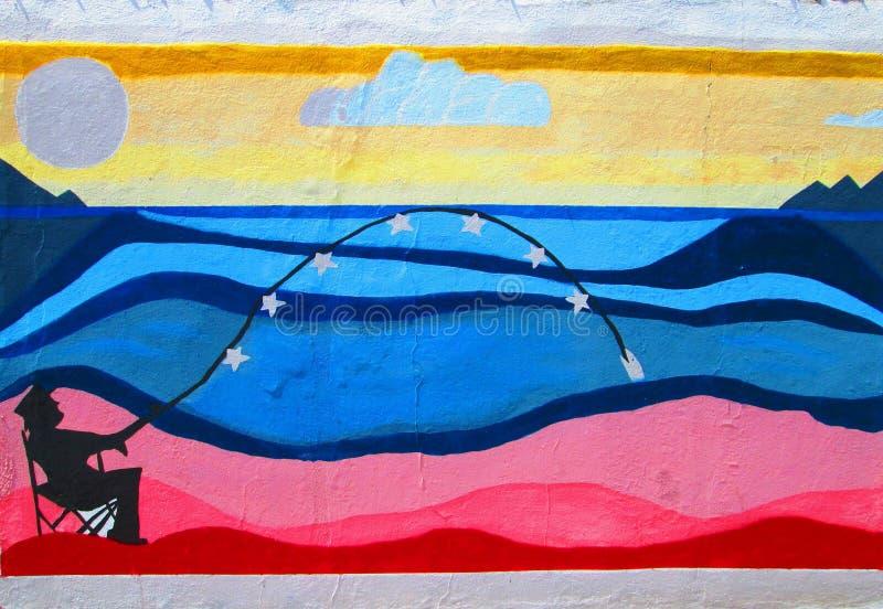 Arte urbano Pescador en la playa de la bandera imagen de archivo