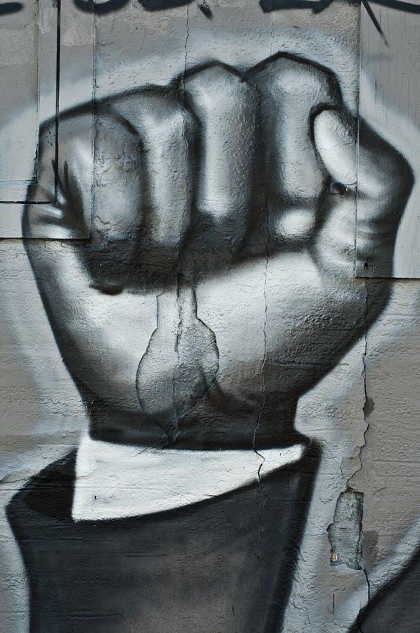 Arte urbano - puño revolucionario imágenes de archivo libres de regalías