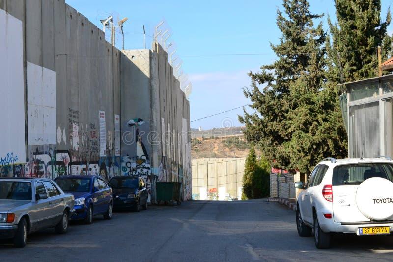 Arte y escrituras en la pared en Belén, entre Palestina Westbank e Israel foto de archivo
