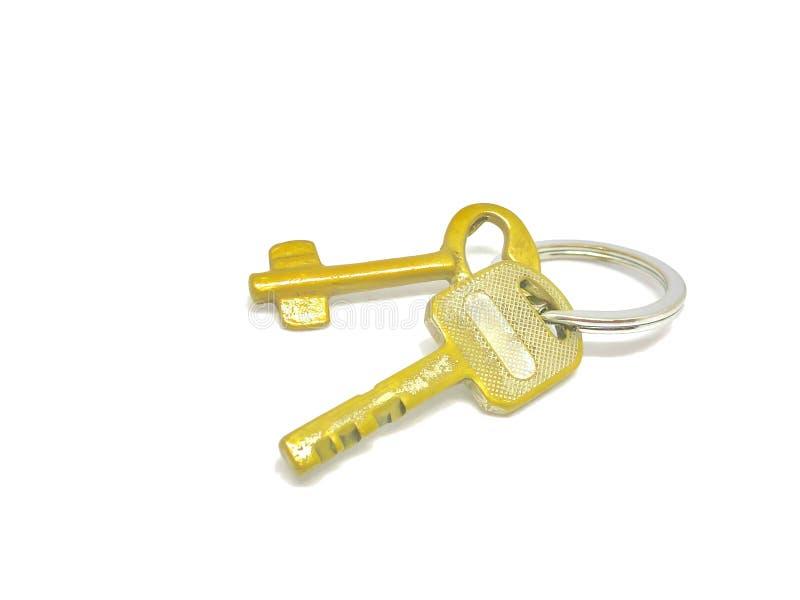 2 Arten goldener Schlüssel im Ring mit mit Hintergrund stockfotografie