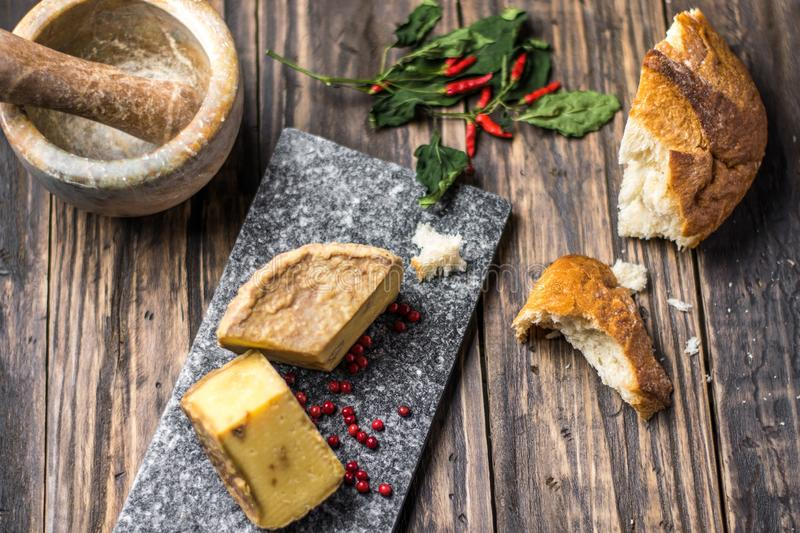 Artesian Cheese and a homemade souer dough bread on wooden background stock image