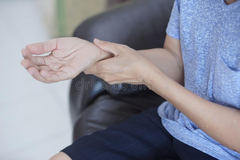 arthritis old person and Elderly woman female suffering from pain at home stock photo