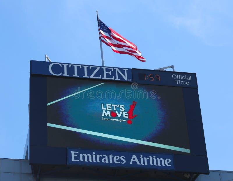 Arthur Ashe Stadium que o placar que promove nos deixou mover o programa tornou-se pela primeira senhora Michelle Obama fotografia de stock