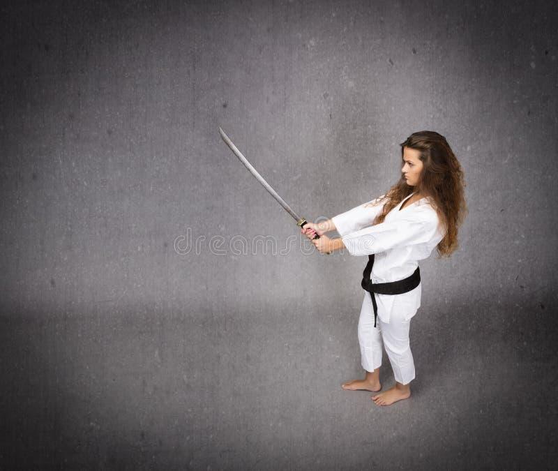 Arti marziali con la spada a disposizione fotografia stock libera da diritti