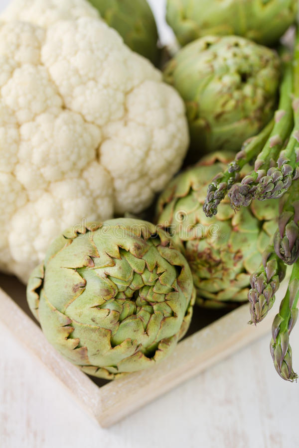 Artichoke with asparagus royalty free stock photo