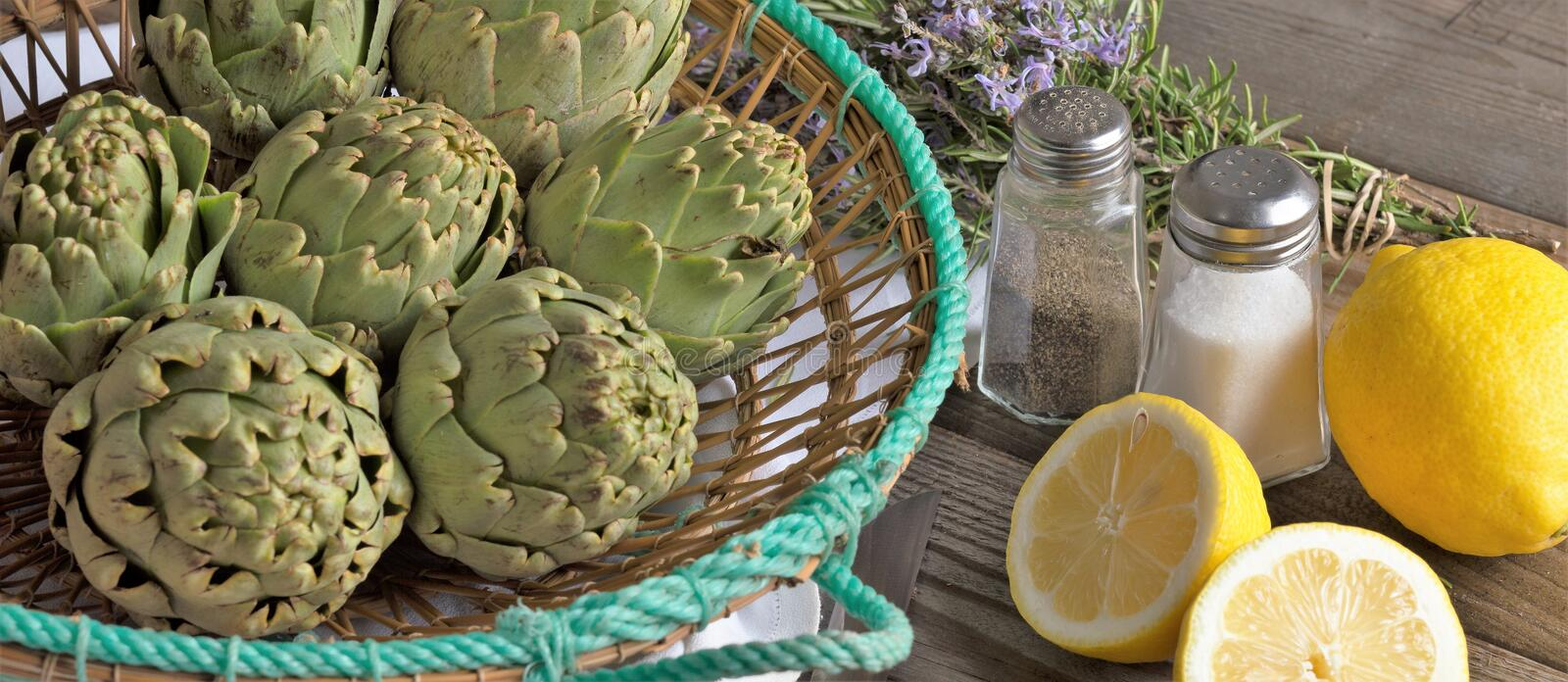 Artichoke. With lemon and pine nuts, field, head, agriculture, thistle, botanic, blossom, organic, cooking, vegetable, beautiful, edible, botanical, background royalty free stock image
