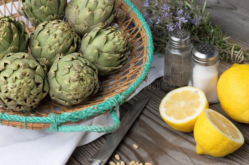 Artichoke. With lemon and pine nuts, field, head, agriculture, thistle, botanic, blossom, organic, cooking, vegetable, beautiful, edible, botanical, background stock images