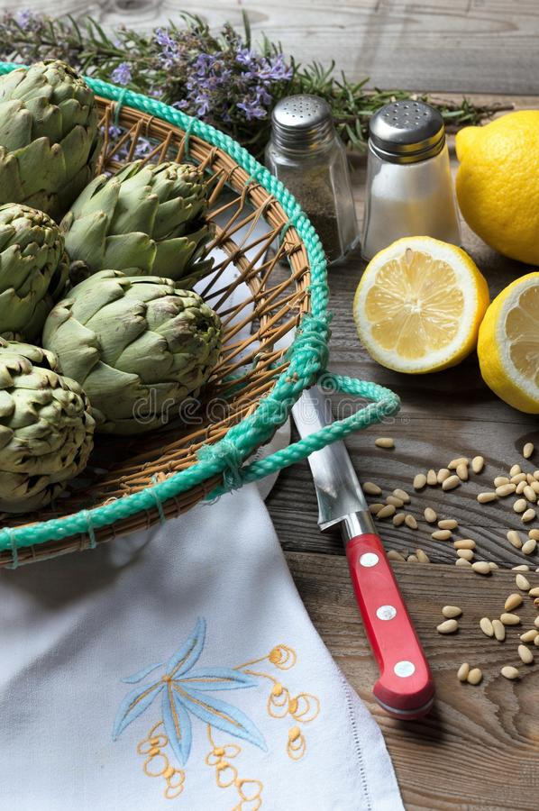 Artichoke. With lemon and pine nuts, field, head, agriculture, thistle, botanic, blossom, organic, cooking, vegetable, beautiful, edible, botanical, background stock photos