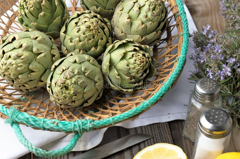 Artichoke. With lemon and pine nuts, field, head, agriculture, thistle, botanic, blossom, organic, cooking, vegetable, beautiful, edible, botanical, background royalty free stock photo
