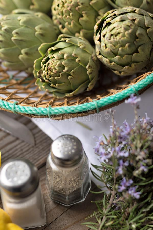 Artichoke. With lemon and pine nuts, field, head, agriculture, thistle, botanic, blossom, organic, cooking, vegetable, beautiful, edible, botanical, background royalty free stock photos
