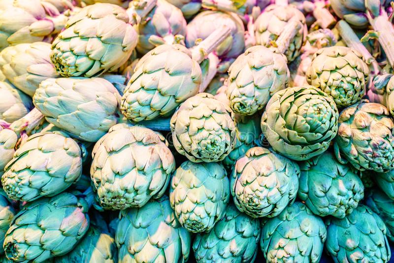 Artichokes on display stock photography