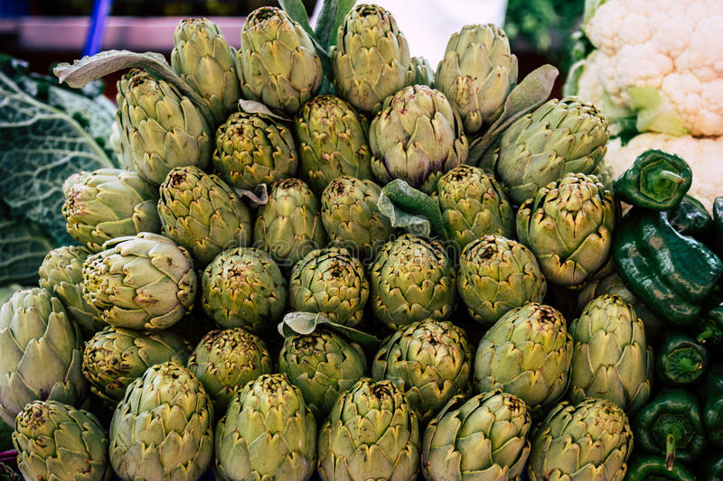 Download Artichokes And Peppers At The Market Stock Image - Image: 83723489