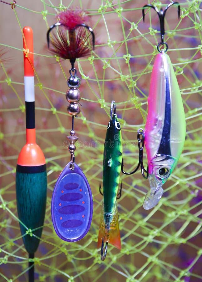 Articles de pêche étroits dans le jour ensoleillé image stock