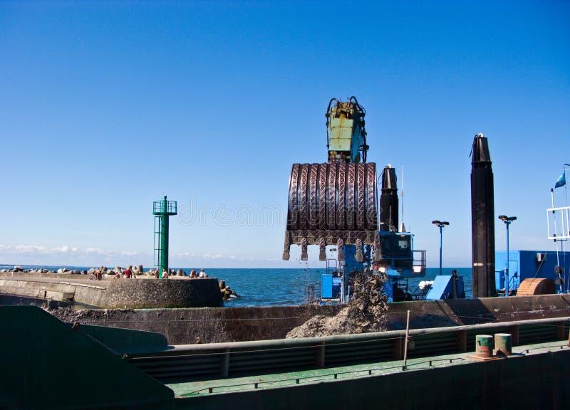 Dredger ship at work in Baltic port entrance stock images