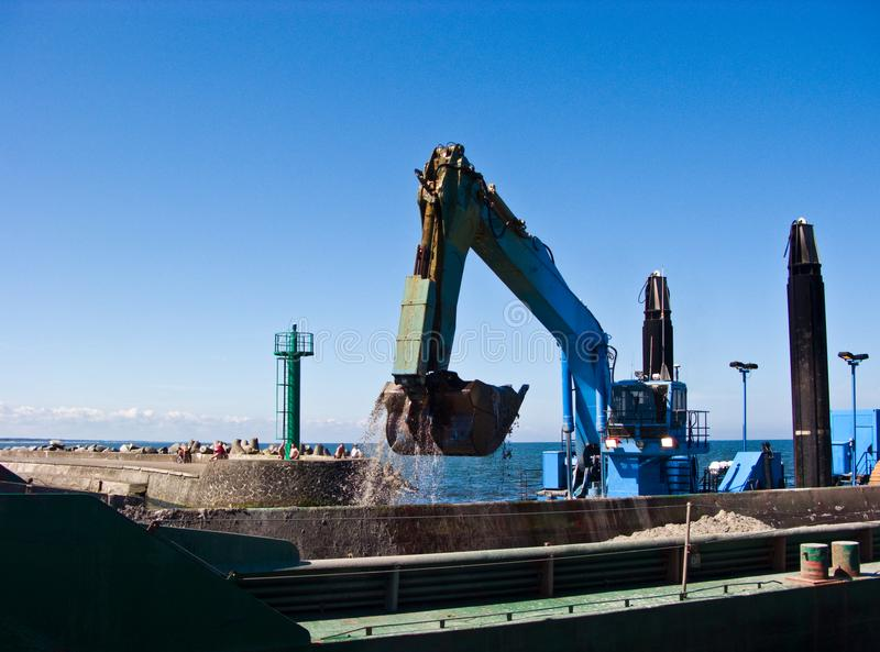 Dredger ship at work in Baltic port entrance royalty free stock photos
