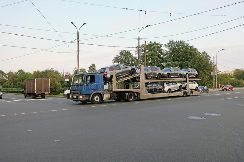 Transportation of new cars on a road train royalty free stock images