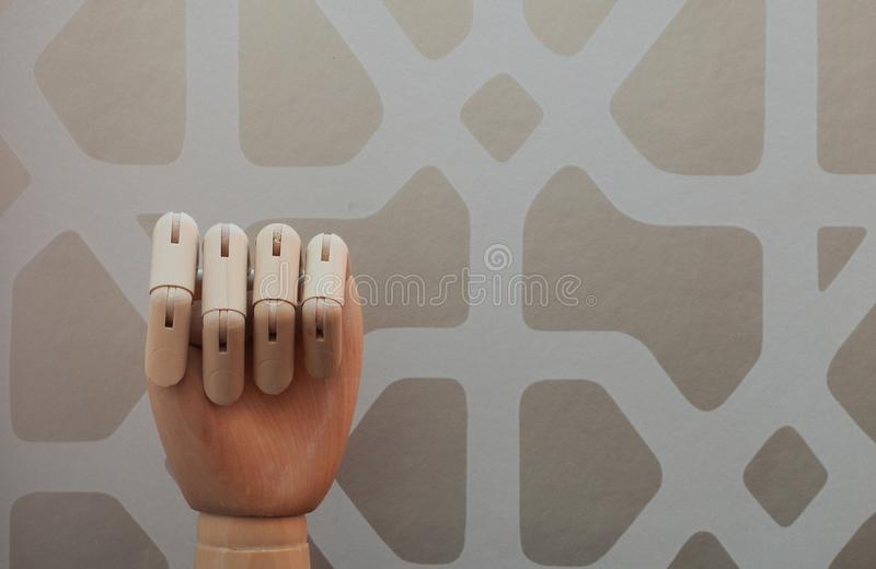 Articulated wooden hand with no raised finger in allusion to number zero stock photo