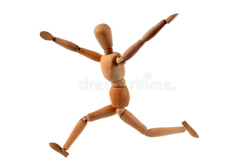Articulated wooden mannequin running on white background stock images