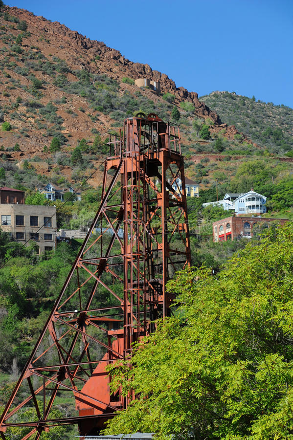 Artifacts from Mining Days. Rusting mining shaft sits on Cleopatra Hill in Jerome, Arizona. Jerome was known as a wild west town stock photo