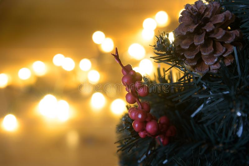 Artificial christmas tree with bokeh lights. In background royalty free stock images