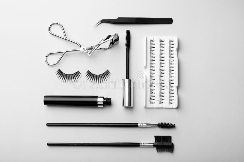 Artificial eyelashes and accessories on grey background royalty free stock photo
