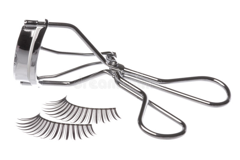Artificial Eyelashes and Curler. Isolated macro image of artificial eyelashes and curler stock image