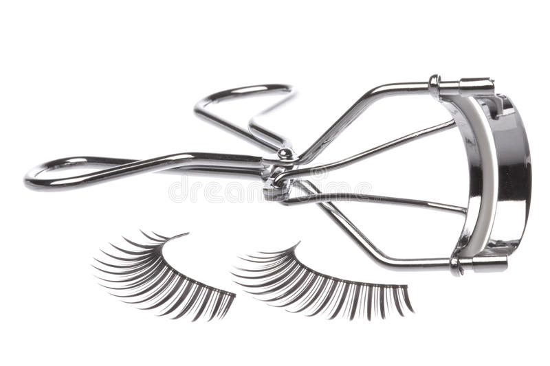 Artificial Eyelashes and Curler. Isolated macro image of artificial eyelashes and curler stock photography