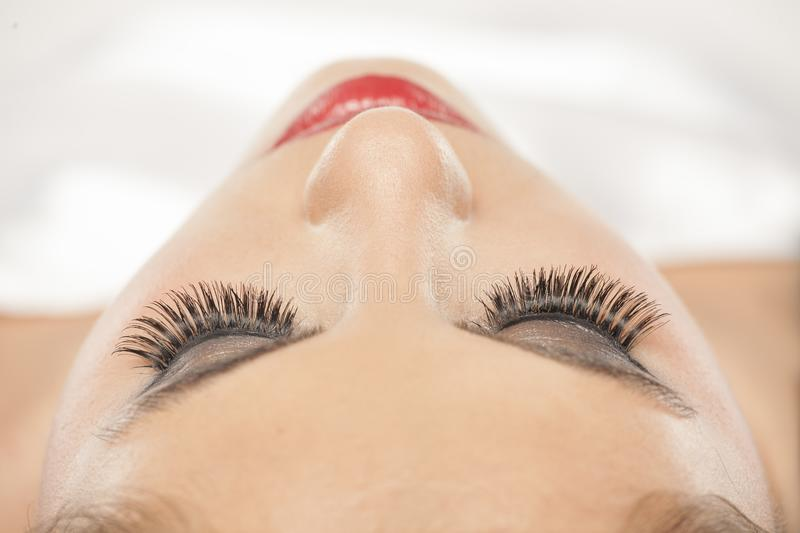 Woman with eyelash extensions royalty free stock image