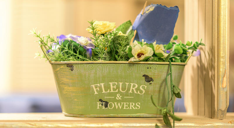 Artificial flower composition. In green hotchpotch stock photos