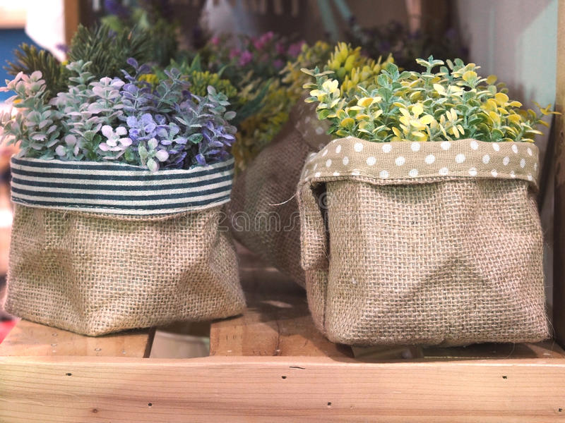 Artificial flowers in flowerpots on shelf. For interior decoration royalty free stock photography
