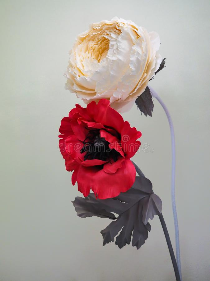 Artificial flowers made of foamiran and paper. stock photo