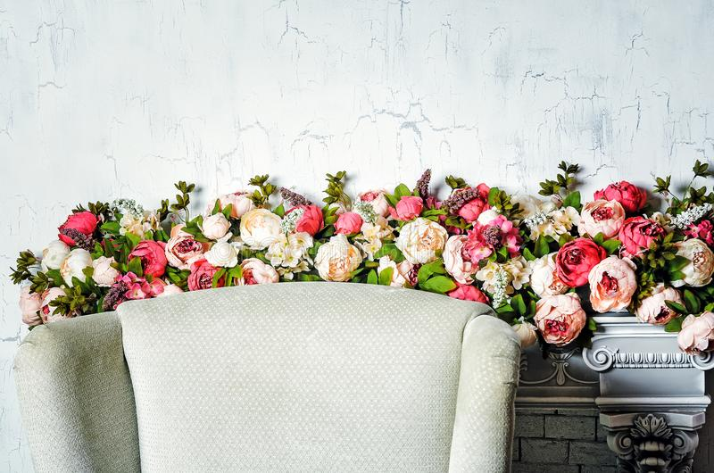 Artificial flowers roses, wedding decorations. Beautiful interior royalty free stock image