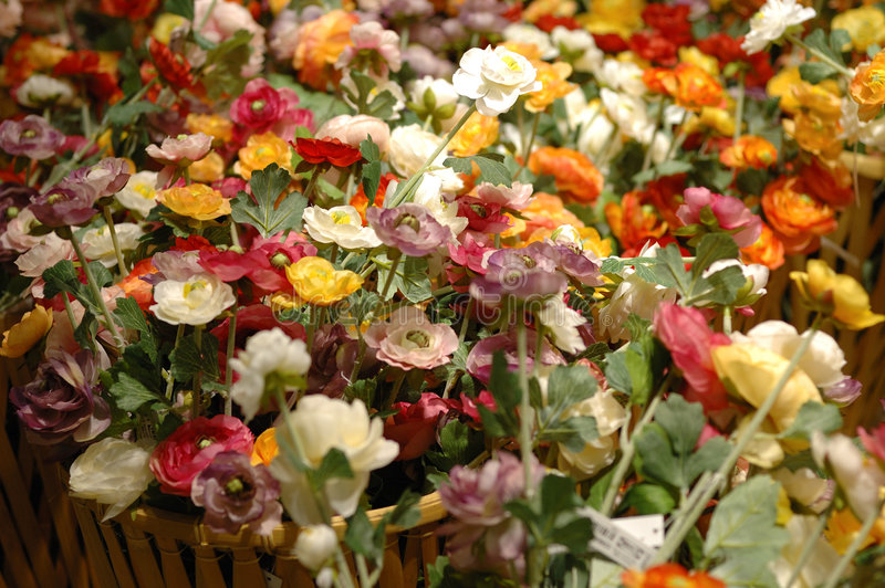 Artificial flowers on selling royalty free stock images