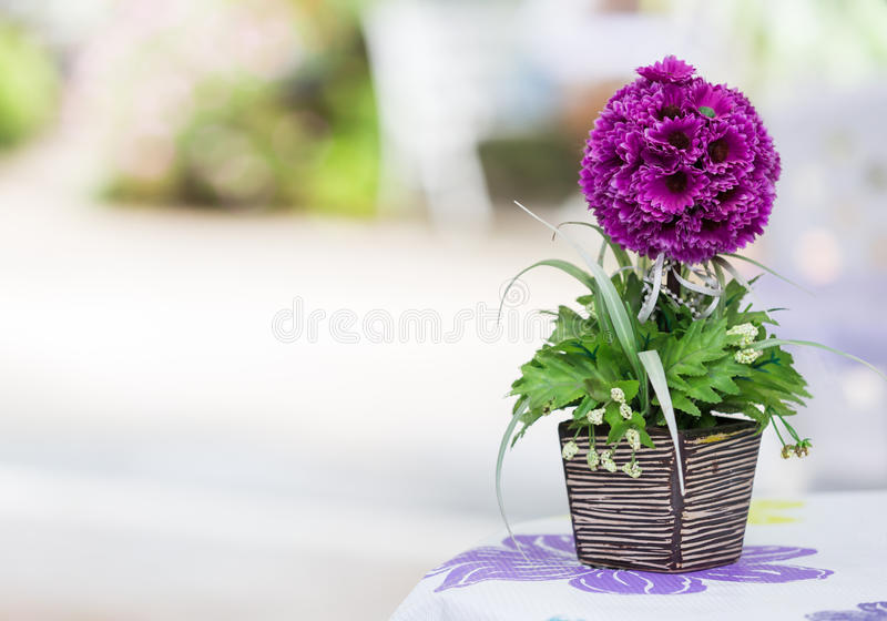 Artificial flowers on the table stock photography