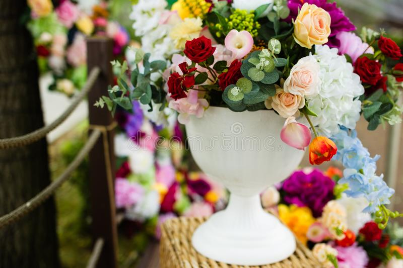 Artificial flowers in a vase. Large bouquet. royalty free stock image