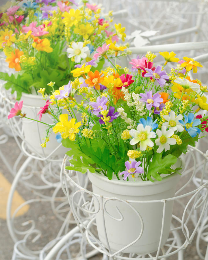 Artificial flowers in white pot stock photo