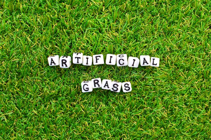 Artificial grass background and little cubes with thematic text. Artificial grass background and little cubes with thematic text stock image