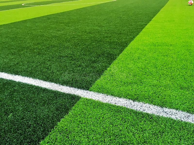 Artificial grass Field with white line background stock photos