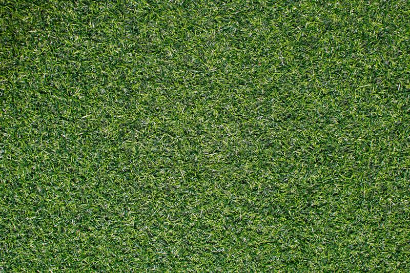 Artificial grass from football field Use as a beautiful green ba stock photo