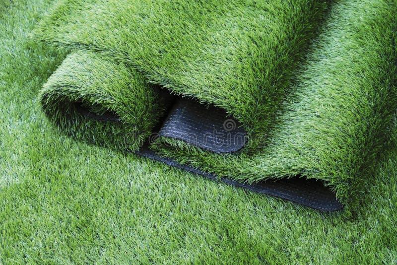 Artificial grass in the garden stock photos