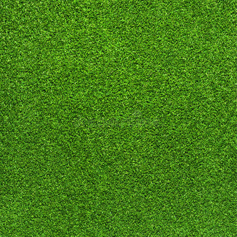Artificial green grass carpet background stock image