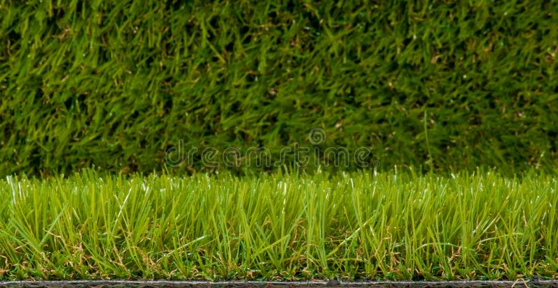 Artificial green grass closeup artificial green turf. Artificial green grass; closeup artificial green turf stock photo