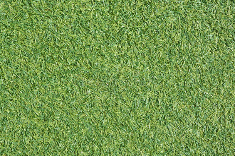 Artificial green grass. Sport field abstract background royalty free stock image