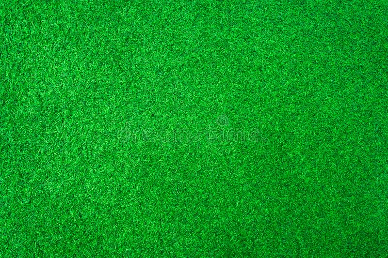 Artificial green grass or sport field texture background stock image