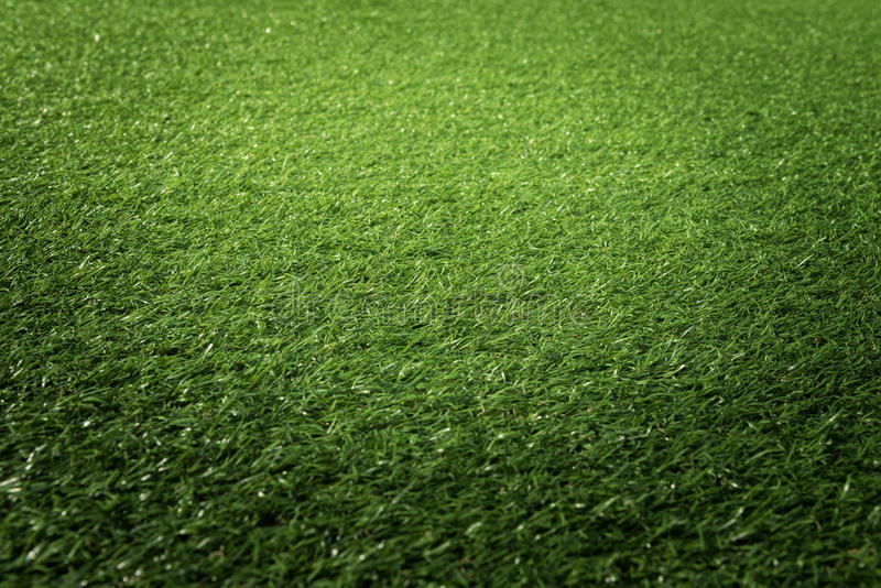 Artificial green grass texture background stock images