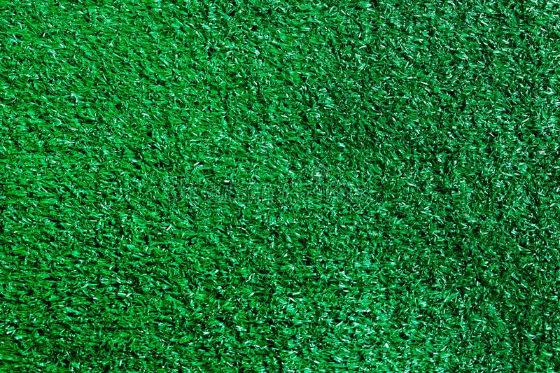 Artificial green grass textured background stock images