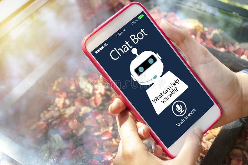 Artificial intelligence,AI chat bot concept. Hands holding mobile phone stock photography