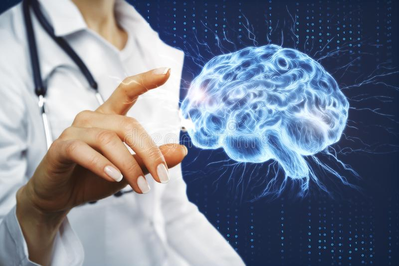 Artificial intelligence and ai concept. Female doctor hand pointing at glowing brain interface. Artificial intelligence and ai concept. 3D Rendering royalty free stock photo